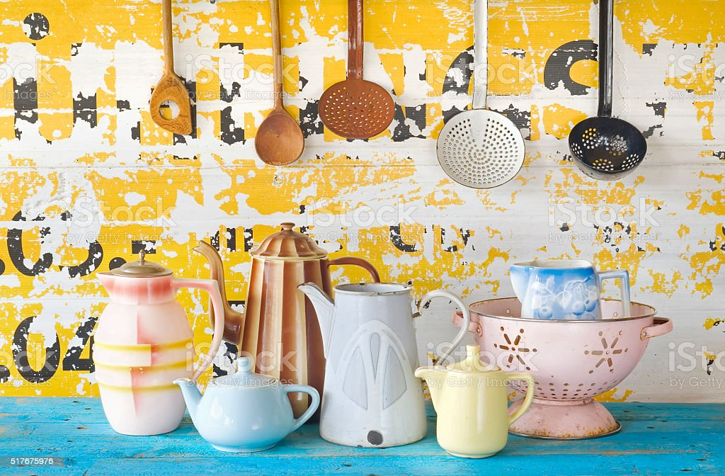 various vintage tableware and kitchen utensils on grungy backgro stock photo