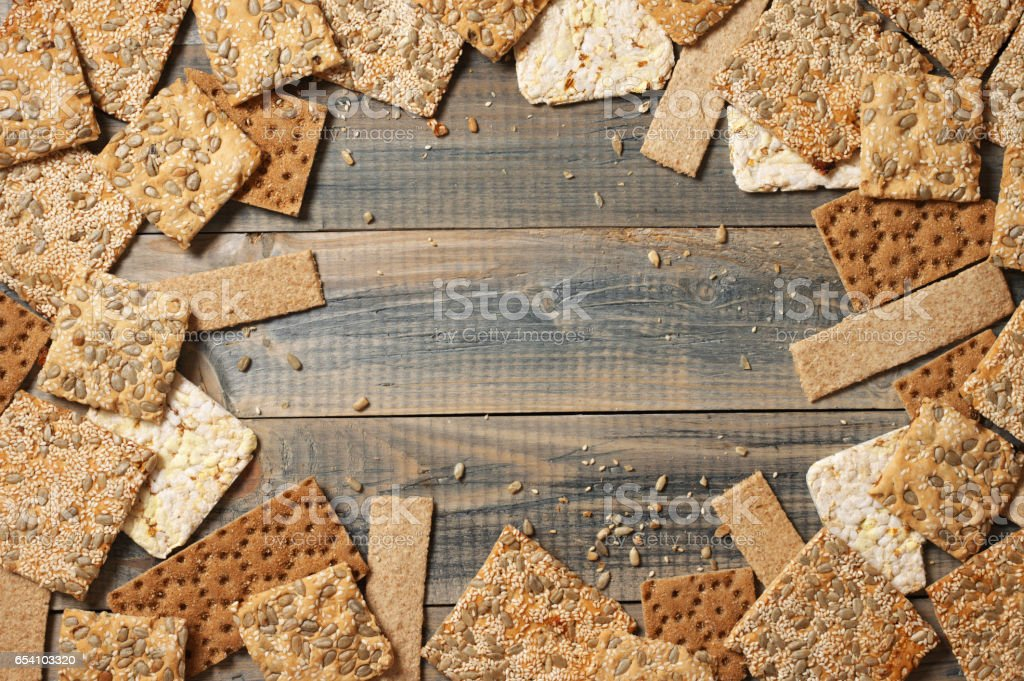 Various whole grain flatbread crackers stock photo