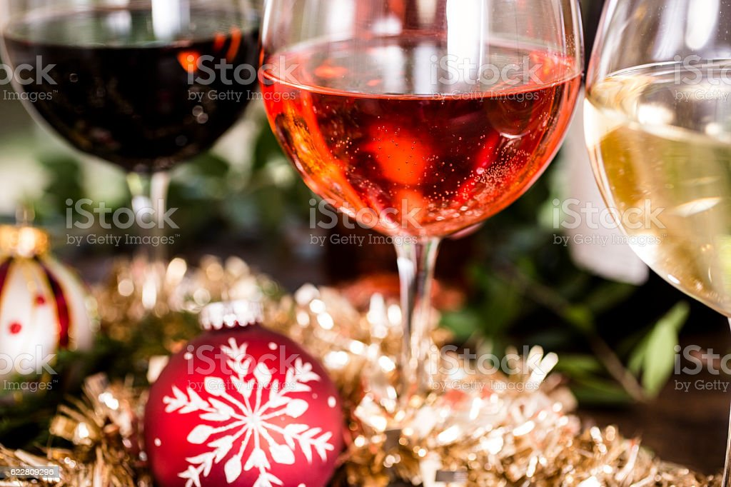 Various wines in glasses on dining table at Christmas. stock photo