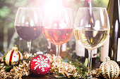 Various wines in glasses on dining table at Christmas.