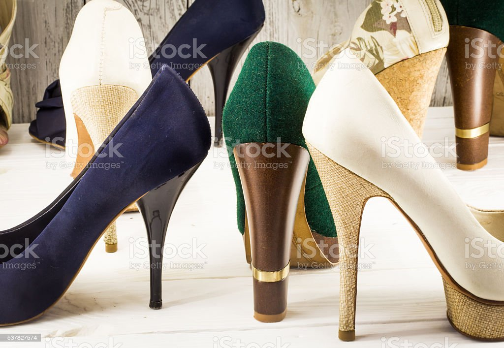 various womens shoes on wooden background stock photo