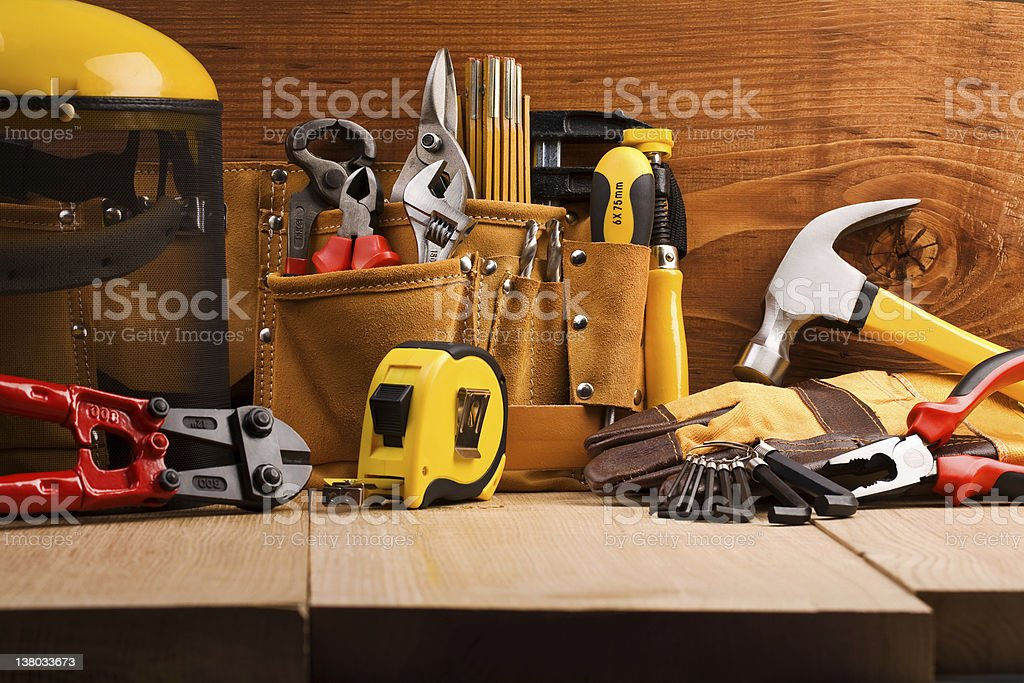 Various working tools on wooden planks stock photo