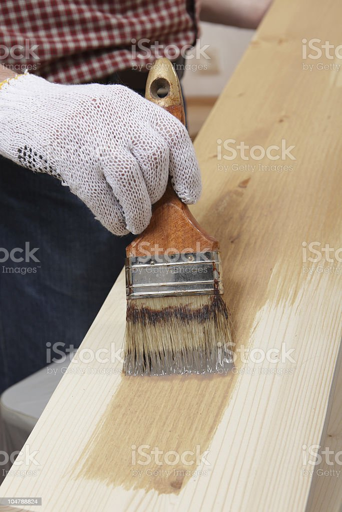 Varnishing a plank royalty-free stock photo