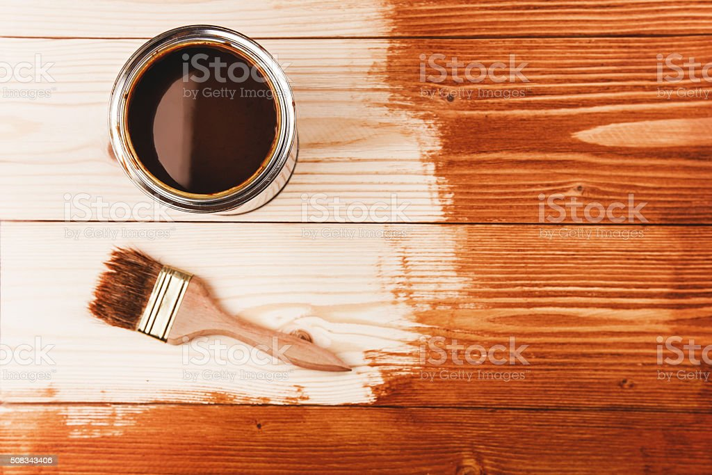 Varnishing a wooden shelf stock photo