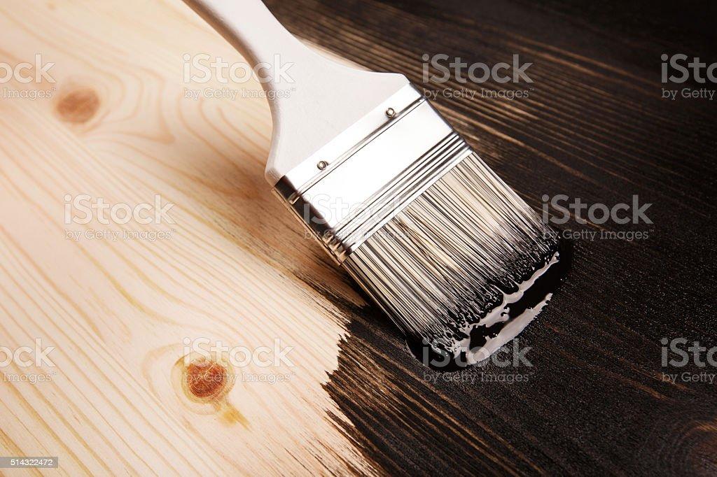 Varnishing natural wood stock photo