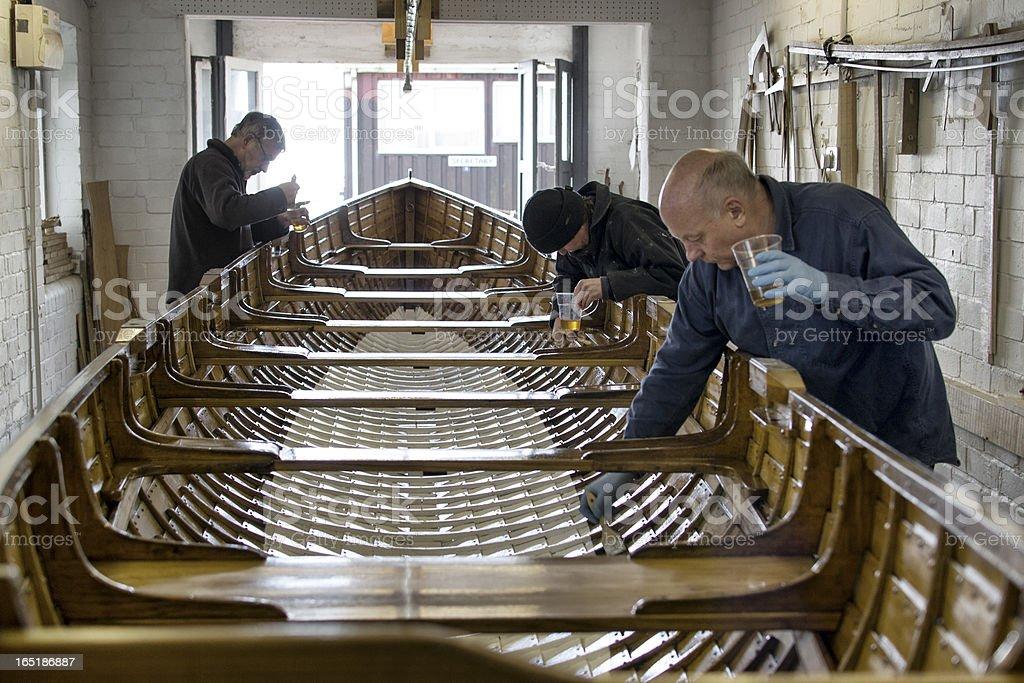 Varnishing the boat stock photo