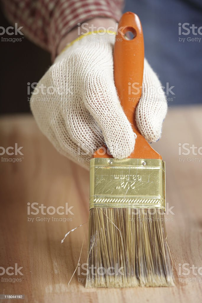 Varnishing the wooden plank royalty-free stock photo