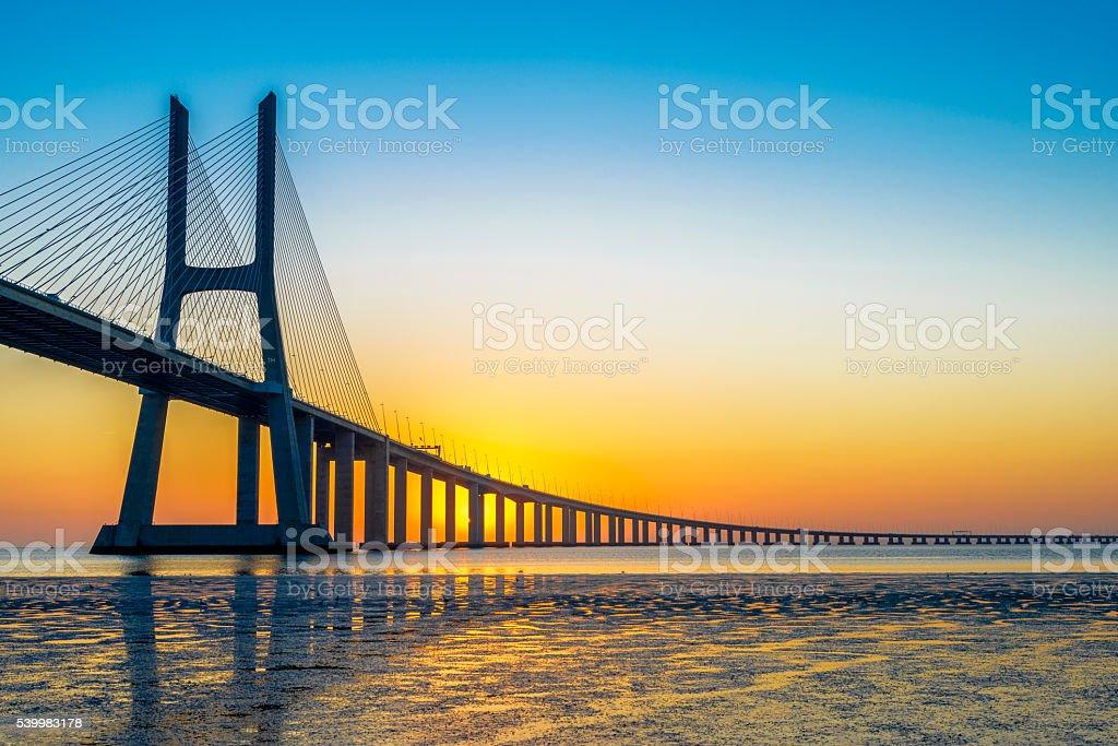 Vasco da Gama Bridge at sunrise stock photo