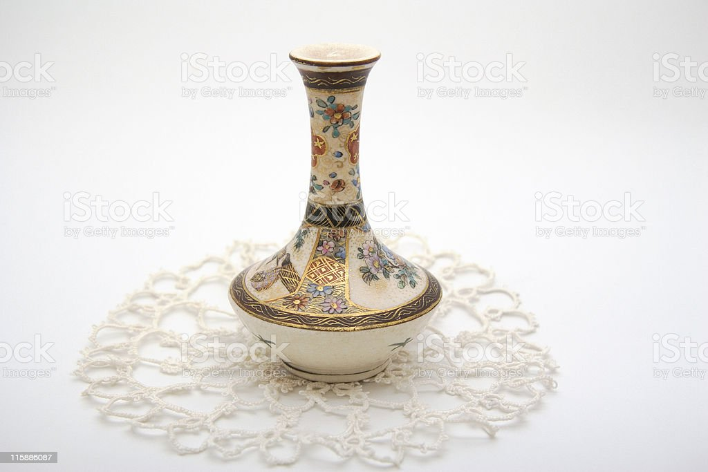 Vase and lace royalty-free stock photo