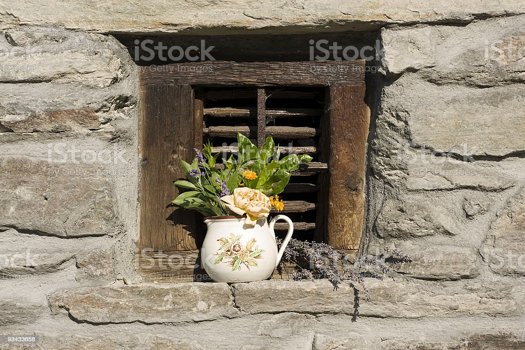 Vase of flowers on the window stock photo