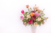 Vase of Roses bouquet on white background