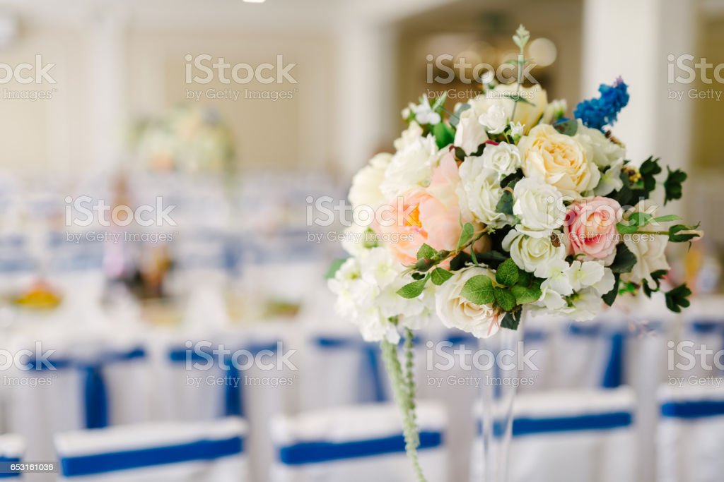 Vase with flowers on the wedding table stock photo