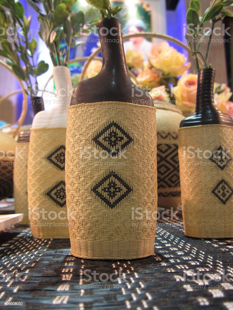 Vases covered with a woven mat. stock photo