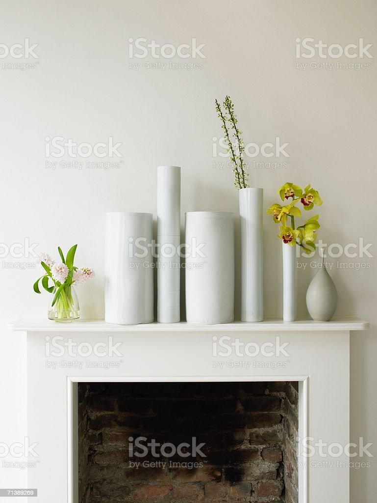 Vases on a mantelpiece stock photo