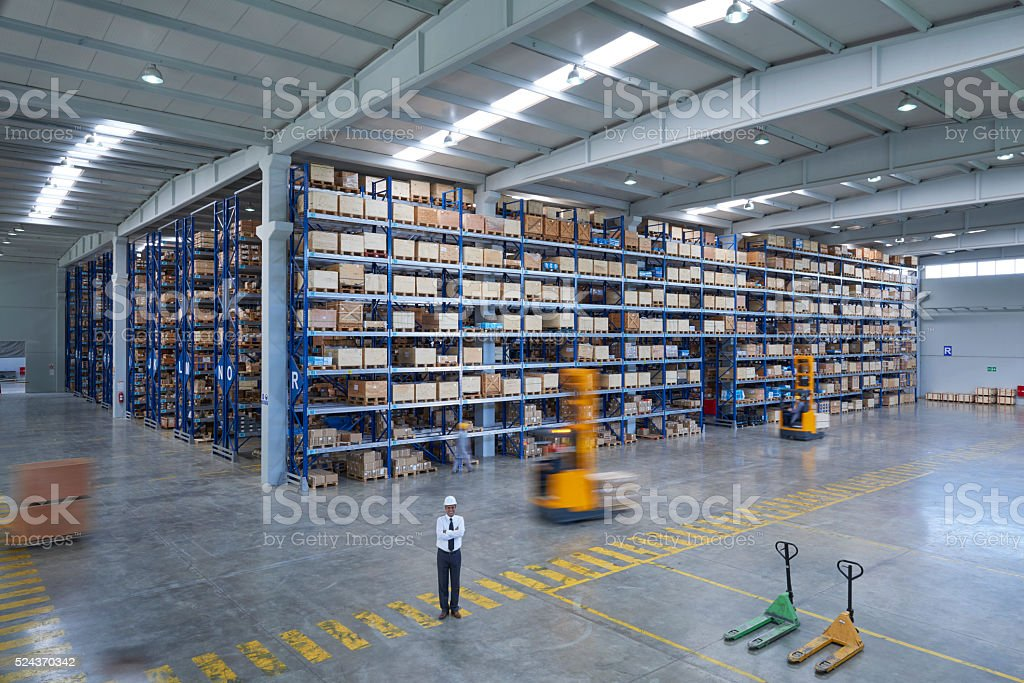 Vast distribution warehouse interior stock photo