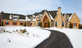 Vast Mansion Home in Winter Accented With Snow