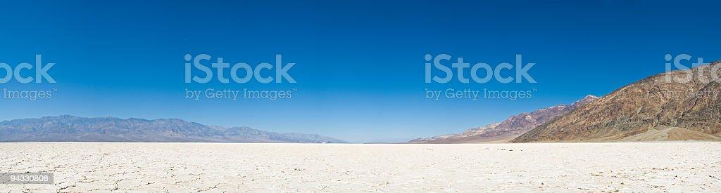 Vast white salt flats, big blue sky stock photo