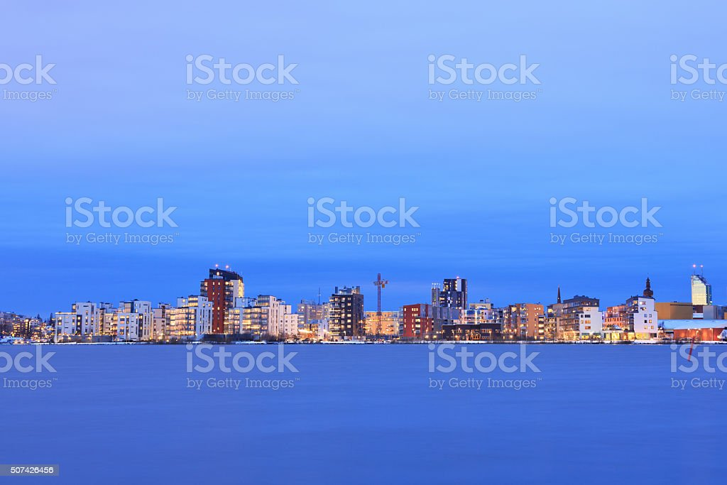 Vasteras skyline in sunset with lake Malaren in the front. stock photo
