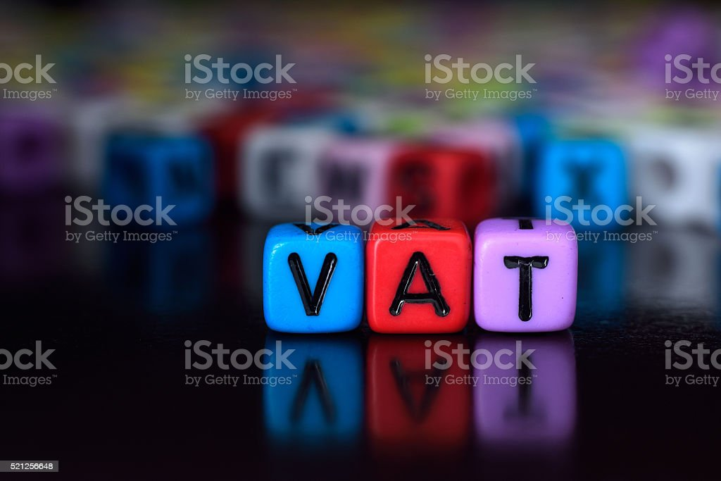 Vat on colorful dice stock photo