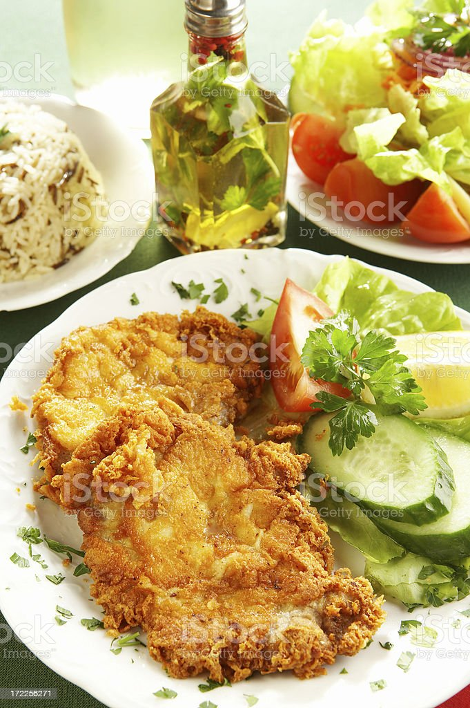 Veal chops in parmesan royalty-free stock photo