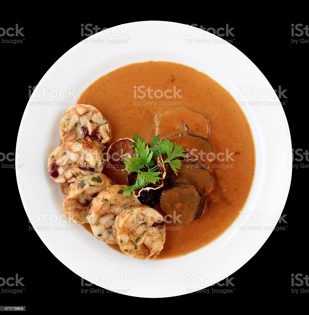Veal fillet with rich sauce and dumplings, isolated royalty-free stock photo