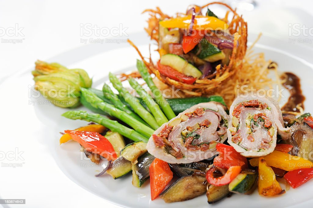 Veal Involtini on Mixed Fried Vegetables royalty-free stock photo
