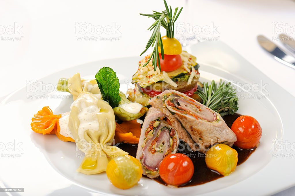 Veal Involtini with Pasta Bonbons and Vegetables royalty-free stock photo