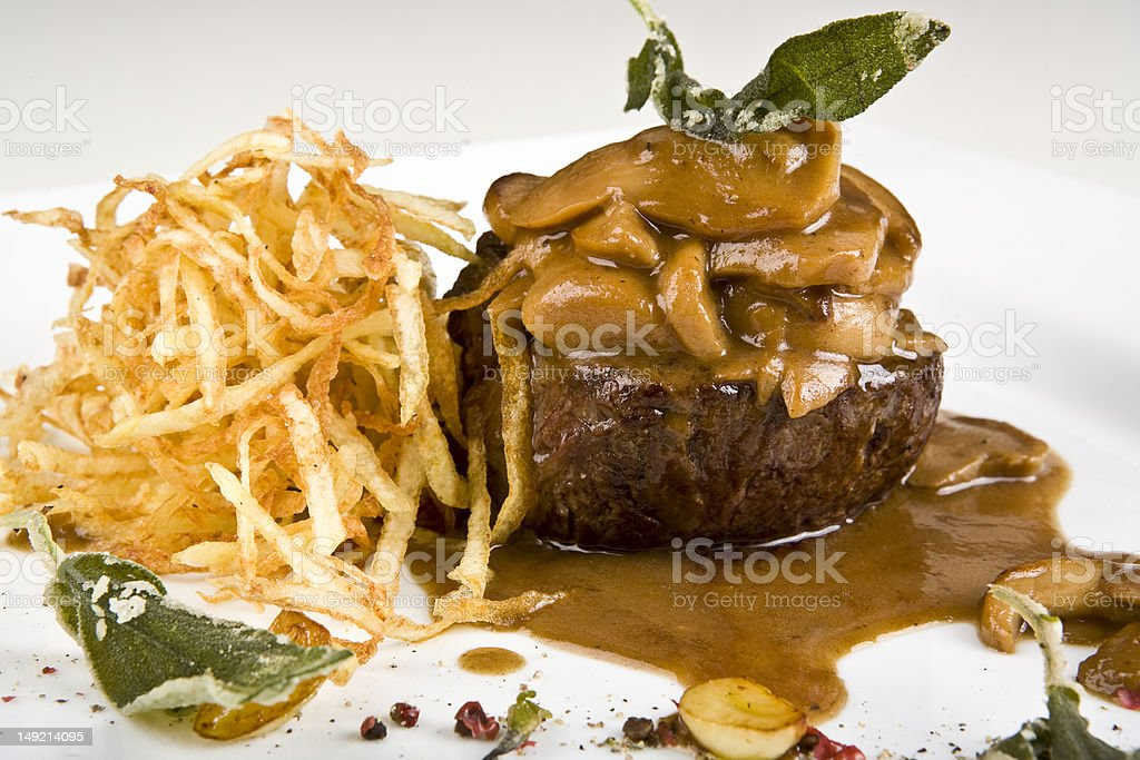 Veal Medallions with Zucchini and ceps royalty-free stock photo