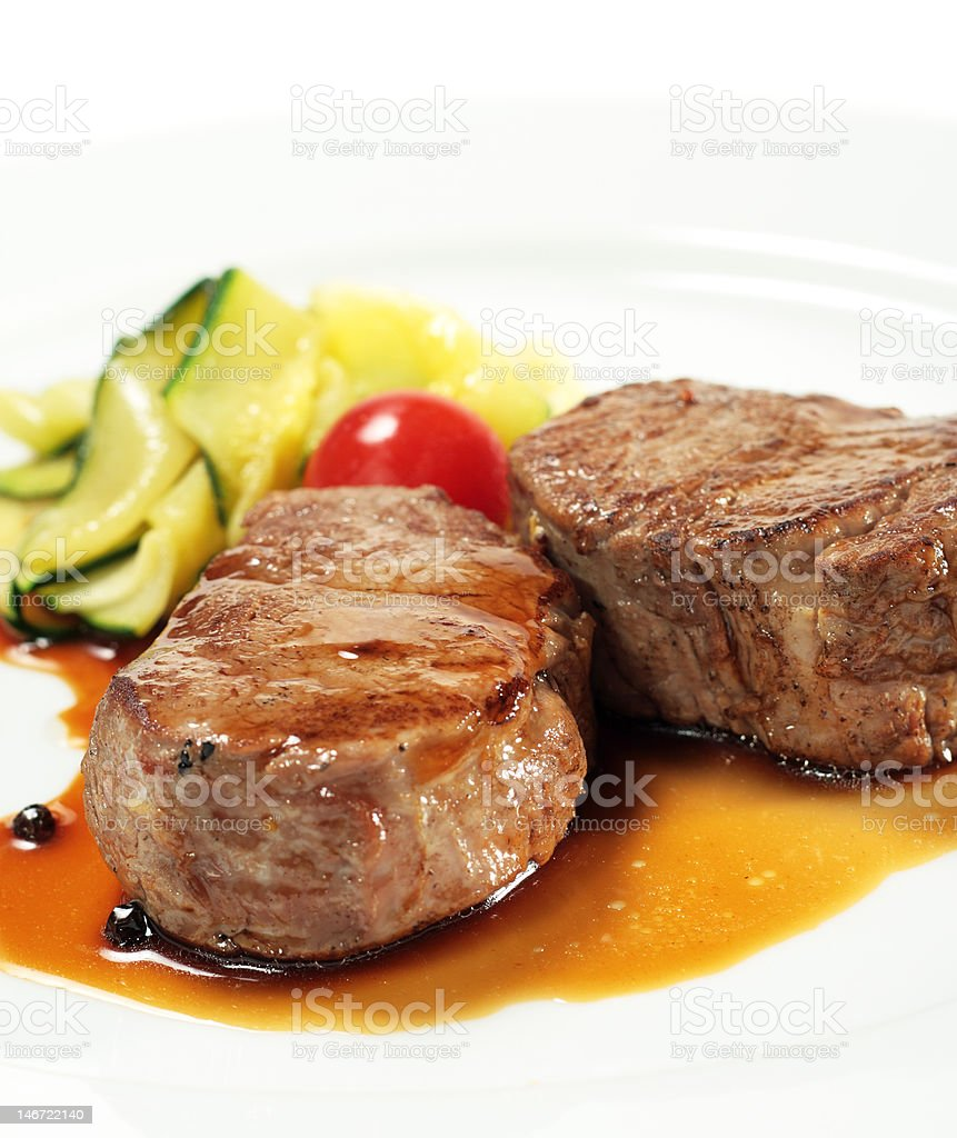 Veal Medallions with Zucchini royalty-free stock photo