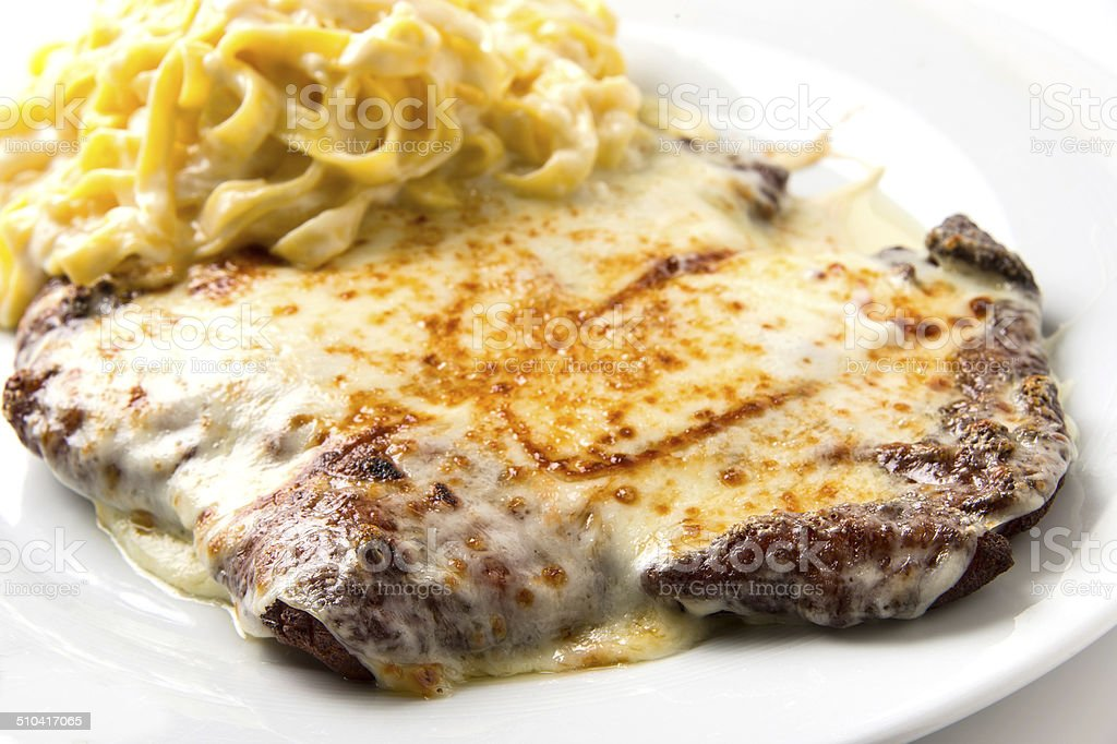 Veal Milanese with fresh Pasta stock photo