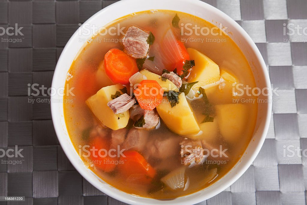 Veal soup with vegetables royalty-free stock photo