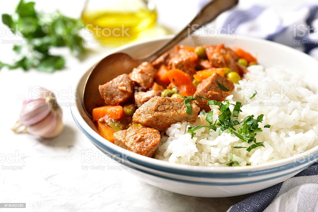 Veal stew served with rice.Vintage style. stock photo