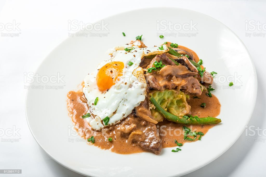 Veal with parsnip puree, asparagus, egg and miso mushroom sauce stock photo