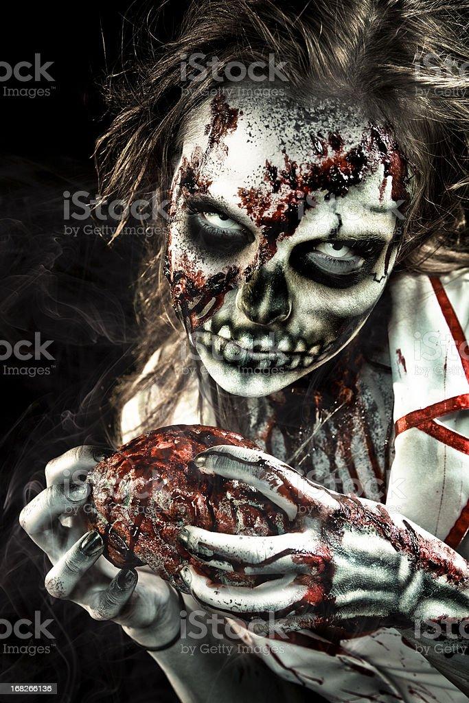 Vector illustration of zombie nurse eating heart stock photo