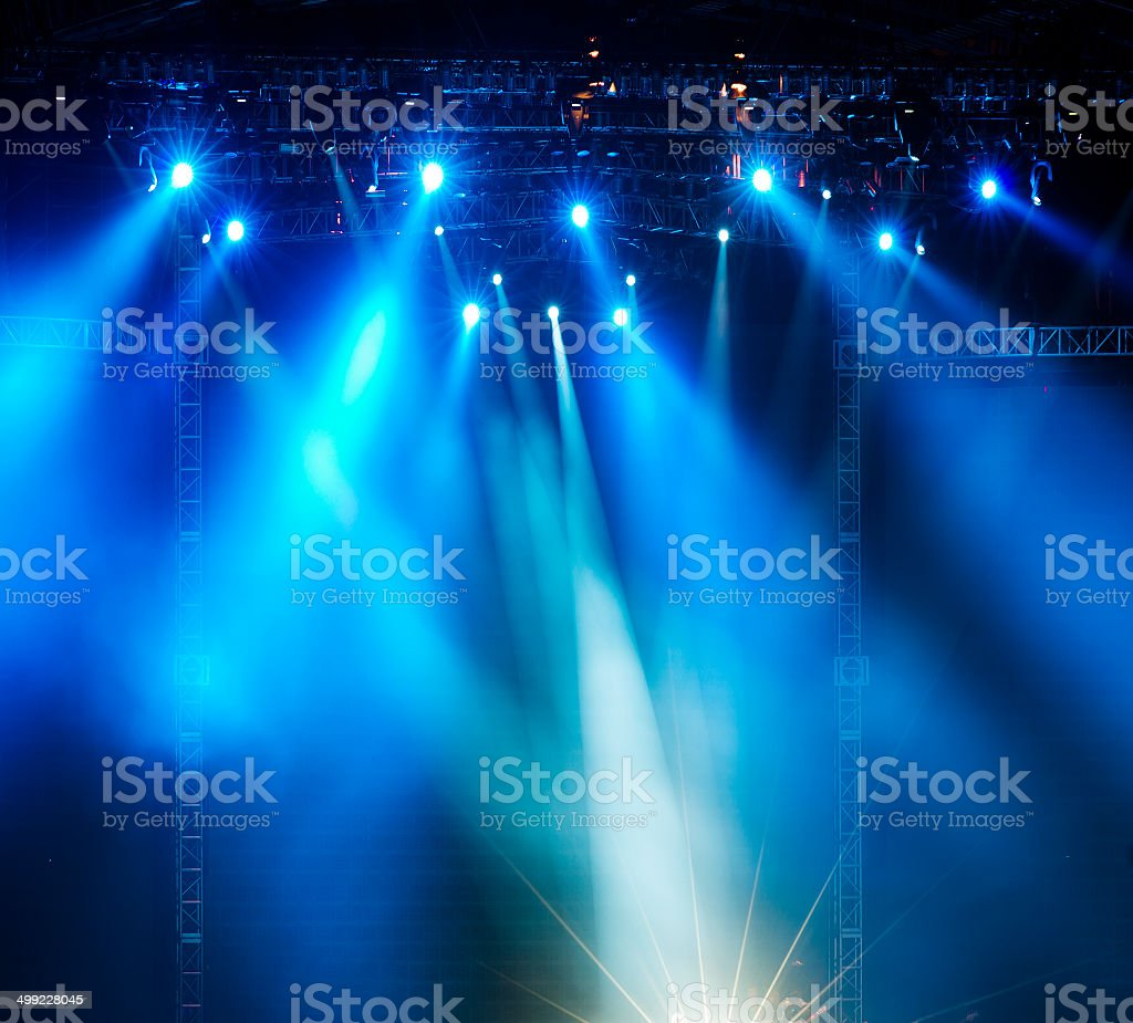 Vector Stage Spotlight with Laser rays vector art illustration