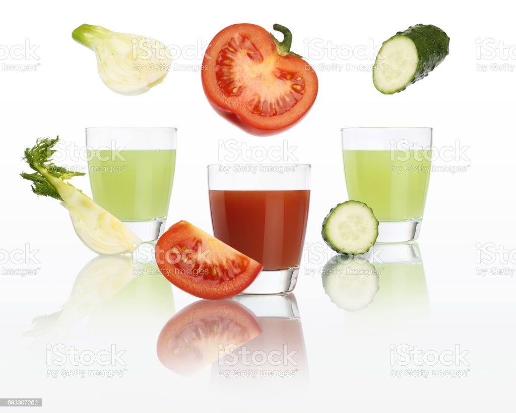 Vegan and diet concept. Tomato, fennel and cucumber juice in glass isolated on white background stock photo