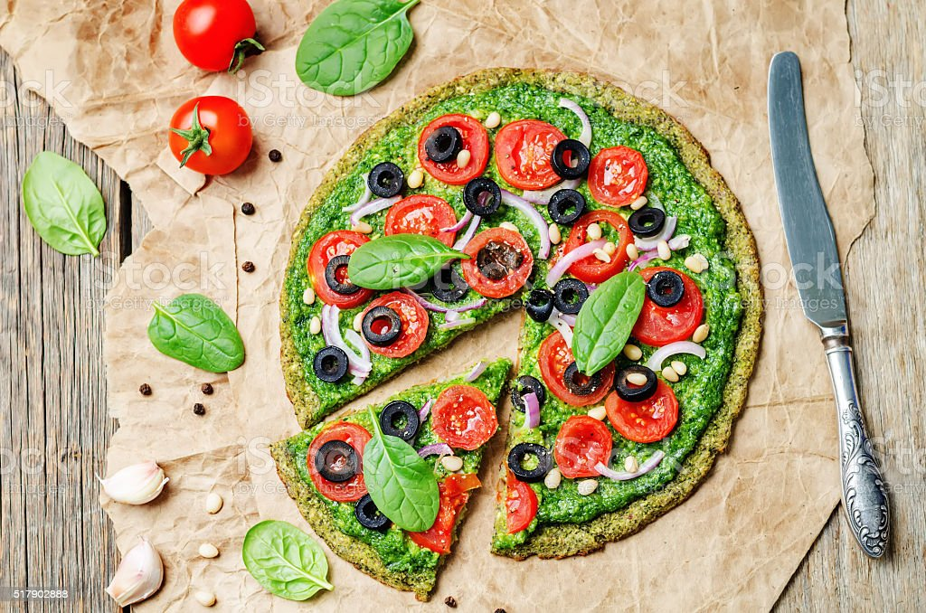vegan broccoli zucchini pizza crust with vegetables stock photo