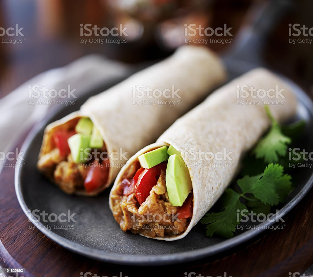 vegan burritos with avocado stock photo
