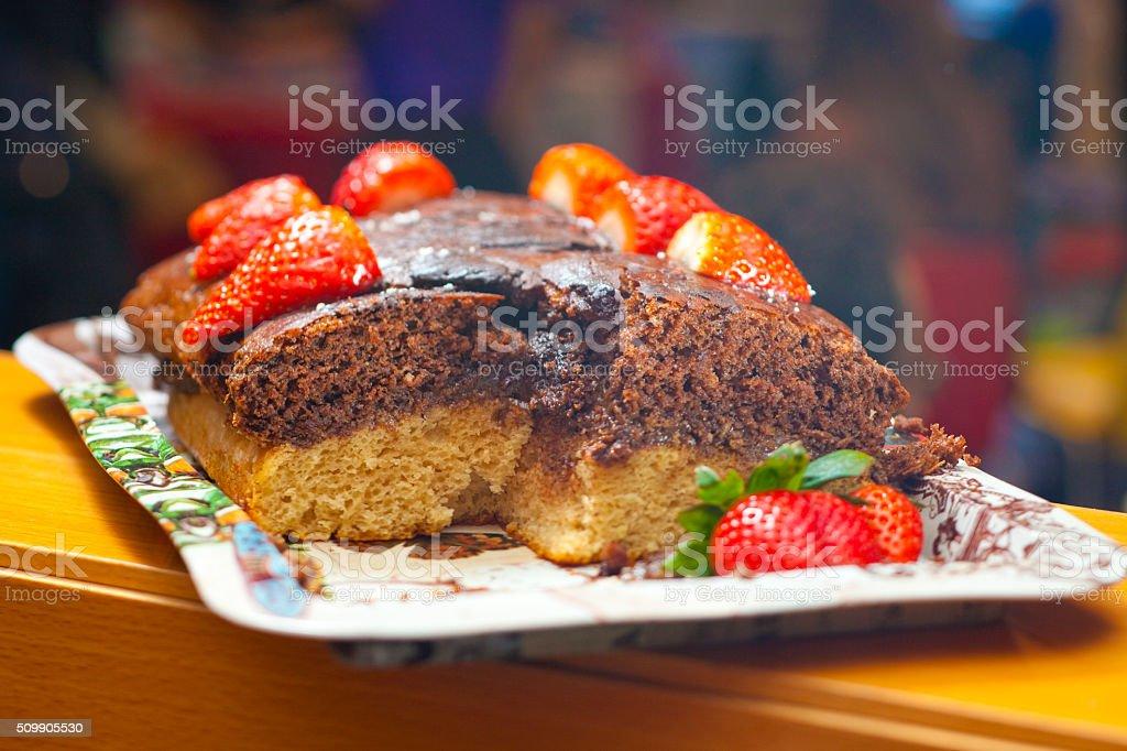 Vegan chocolate and strawberry cake stock photo