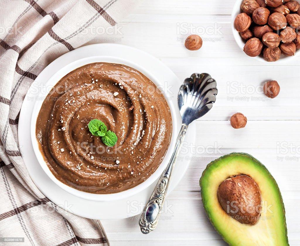 Vegan chocolate pudding from avocado and hazel milk stock photo