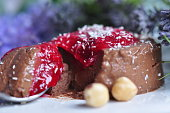Vegan coconut chocolate pannacotta with raspberry sauce