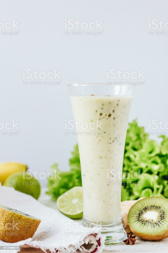 Vegan drink - smothie made from fresh ginger and fruits. stock photo