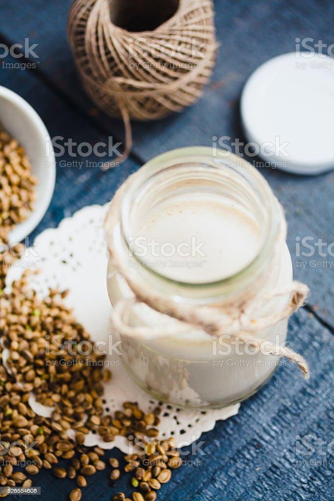 vegan fresh milk from hemp seeds, glass jar, clean eating stock photo