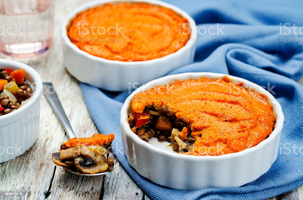 vegan green lentil mushroom sweet potato Shepherds pie stock photo
