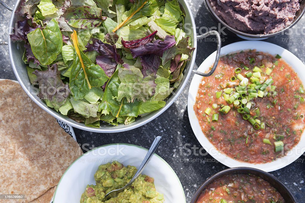 Vegan Mexican - Tortillas, Salsa, Guacomole, Refried Beans & Salad royalty-free stock photo