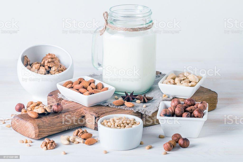 Vegan milk from nuts in glass jar stock photo