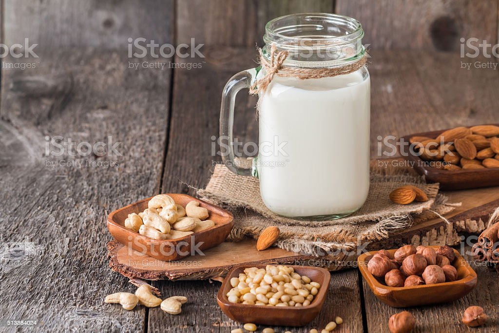 Vegan milk from nuts in glass jar stock photo