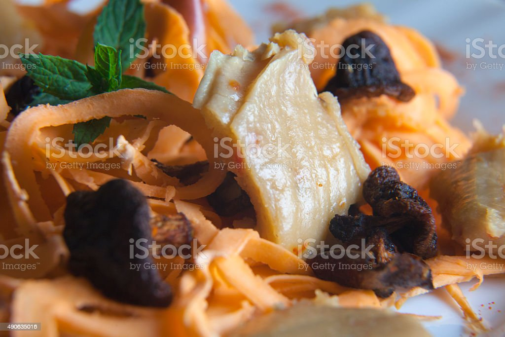 Vegan pasta with sweet potato, dried mushrooms and cashew cheese stock photo