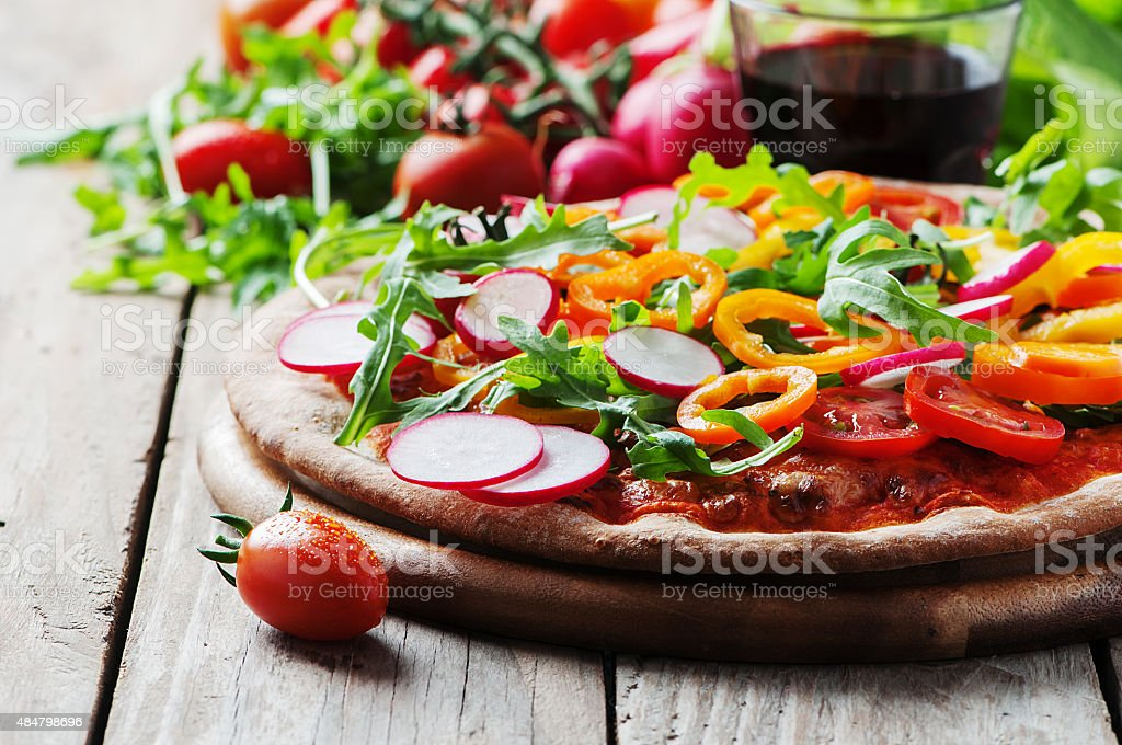 Vegan pizza with radish, tomato and paprika stock photo