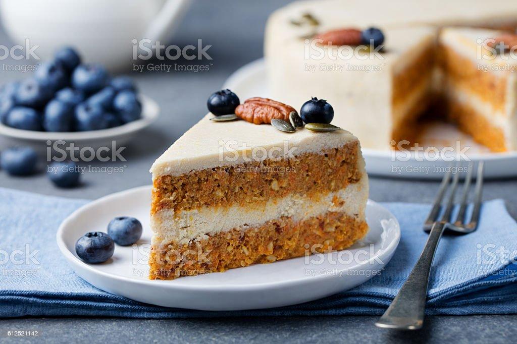 Vegan, raw carrot cake. Healthy food. Grey background stock photo